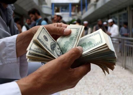 Dollar resumes ascent as investors panic about coronavirus, scramble for cash