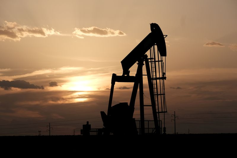 Oil prices jump $1 as sharp falls draw investors, bargain buyers